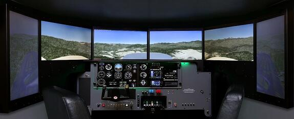 Picture of a Redbird FMX with Display Configuration Version 3, 27 inch monitors with rotated wing displays