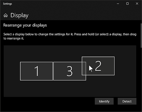 Windows 10 Display Settings menu, with a cursor dragging one of the displays into position
